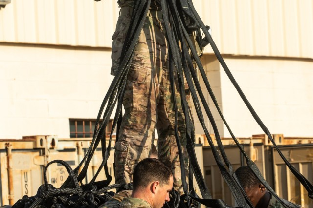 Advisors from 1st Security Force Assistance Brigade, prepare a sling load for delivery during the Advisor Forge training exercise at Fort Benning, GA, August 13, 2019.  Sling loads are transported via aircraft to locations in need of supplies. (U.S. Army photo by Pfc. Daniel J. Alkana/ 22 Mobile Public Affairs Detachment.)