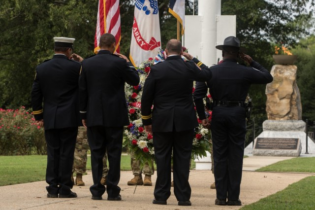 First responders with the Fayetteville Fire Department and Spring Lake Police Department salute a wreath during the Fort Bragg 9/11 Remembrance Ceremony on Fort Bragg, N.C. Sept. 11, 2019. The ceremony highlighted both U.S. Army Soldiers and United States first responders who participated and were affected by the terror attacks on Sept. 11, 2001. (U.S. Army Photo by Pfc. Joshua Cowden / 22nd Mobile Public Affairs Detachment)