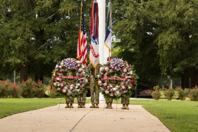 Wreaths placed on the Fort Bragg Main Post Parade Field during the Fort Bragg 9/11 Remembrance Ceremony on Fort Bragg, N.C. Sept. 11, 2019. The ceremony featured guest speakers, a firing party, a wreath laying ceremony and performances from The 82nd Airborne Division Band and the 82nd Airborne Division Chorus. (U.S. Army Photo by Pfc. Joshua Cowden / 22nd Mobile Public Affairs Detachment)