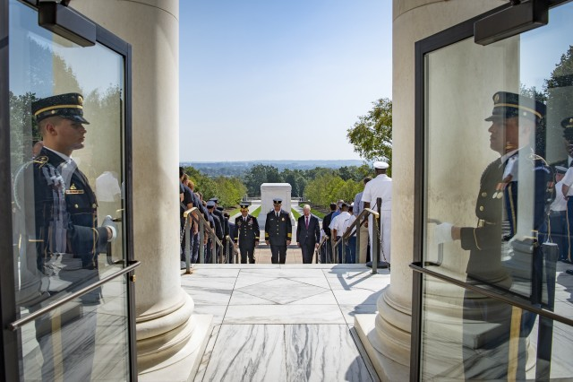 (From left to right, center) U.S. Army Maj. Gen. Omar Jones IV, commanding general, U.S. Army Military District of Washington; David Povlitz, chief, Arlington County Fire Department; and James Schwartz, former chief, Arlington County Fire Department; participate in an Army Honors Wreath-Laying Ceremony at the Tomb of the Unknown Soldier at Arlington National Cemetery, Arlington, Virginia, Sept. 11, 2019. ACFD was the lead agency in response to the Pentagon attack on 9/11, led by Schwartz. (U.S. Army photo by Elizabeth Fraser / Arlington National Cemetery / released)