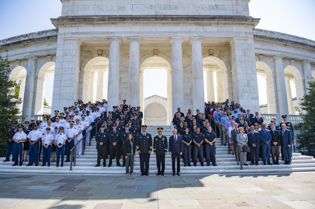 Members of the Joint Force Headquarters National Capital Region / U.S. Army Military District of Washington and the Arlington County Fire Department pose for a photo on the West Steps of the Memorial Amphitheater at Arlington National Cemetery, Arlington, Virginia, Sept. 11, 2019. Both MDW and ACFD played major roles in responding to the terrorist attack on the Pentagon on 9/11. (U.S. Army photo by Elizabeth Fraser / Arlington National Cemetery / released)