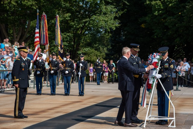 The Military District of Washington conducts an Army Honor Wreath Ceremony in honor of the interagency partnership between the Arlington County Fire Department and Joint Force Headquarters-National Capital Region at Tomb of the Unknown Soldier in Arlington National Cemetery, Virginia, September 11, 2019. David Povlitz, chief of the Arlington County Fire Department, and James Schwartz, the former chief, participated in the wreath-laying ceremony hosted by Maj. Gen. Omar J. Jones IV, commanding general, Joint Force Headquarters - National Capital Region and the U.S. Army Military District of Washington. (U.S. Army photo by Sgt. Maryam Treece)