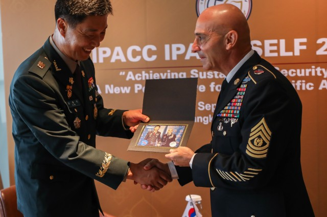 Command Sgt. Maj. Benjamin Jones, CSM, USARPAC presents a photo to Sgt. Maj. of the Army ChaeSik Kim, Republic of Korea Army at the end of their bi-lateral meeting during the Senior Enlisted Leadership Forum held in Bangkok Thailand 9-11 September 2019. IPACC/IPAMS/SELF are a series of Department of the Army and U.S. Army Pacific forums to build interpersonal relationships and foster multilateralism, dialogue, and cooperation for regional approaches to contemporary security challenges in the Indo-Pacific.