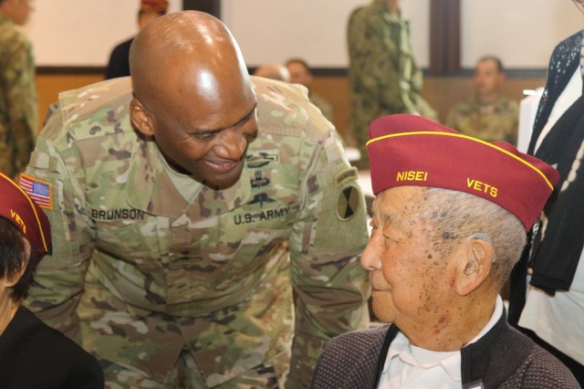 Maj. Gen. Xavier Brunson, 7th Infantry Divison commanding general, welcomes Nisei veterans inside the Nisei Veterans Committee Memorial Hall, Sept. 8, during the Beyond Reconciliation celebration. Beyond Reconciliation hosted by the Nisei Veteran's Committee and the Japan-American Society of the State of Washington, celebrated the contributions and service of Nisei veterans and their lasting legacy on the alliance between the U.S. and Japan, at the Nisei Veterans Committee Memorial Hall, Sept. 8. The second annual luncheon welcomed the 7th Infantry Division, the Illinois National Guard and the Japan Ground Self-Defense Force. The Illinois National Guard and the JGSDF have been training together for the past three weeks at Yakima Training Center, Washington. (U.S. Army Reserve Photo by 1st Lt. Ariana-Jasmine Castrellon)