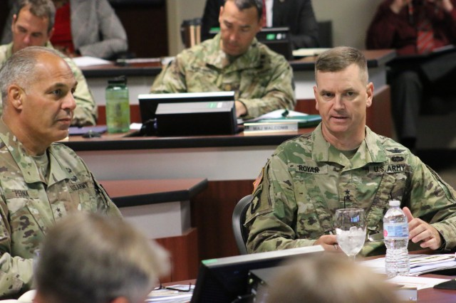 Army Materiel Command's Commander Gen. Gus Perna receives an update from Aviation and Missile Command's Commander Maj. Gen. Todd Royar during the quarterly briefing at AMCOM headquarters, Sept. 10.