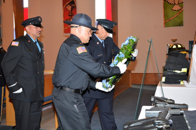 The White Sands Missile Range, Directorate of Emergency Services Honor Guard conducted the placing of the wreath as a tribute to those we lost on Sept. 11, 2001. From left, Firefighter Jorge Chacon, Lieutenant Kevin J. Mower, and Lieutenant Michael De La Paz.