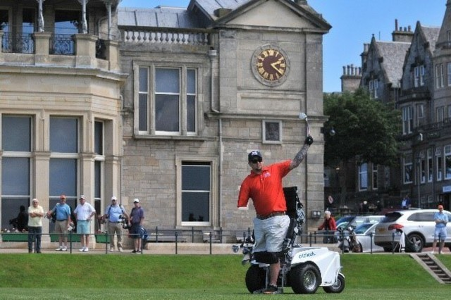 Retired U.S. Army Sgt. Aaron Boyle takes a tee shot at St Andrews Golf Course in St Andrews, Scotland from the para-golfer electric cart in June 2014. (Photo courtesy Aaron Boyle)