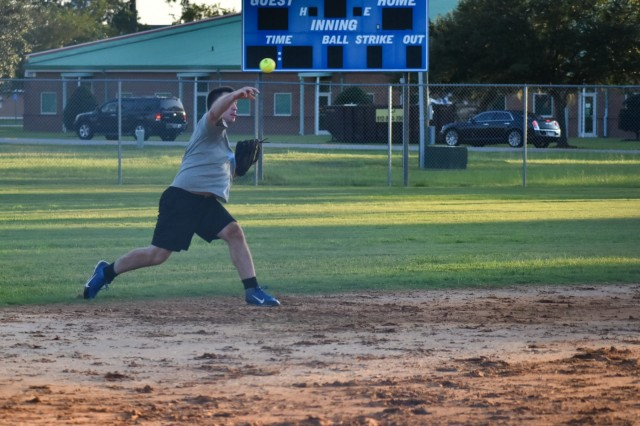 Legion shortstop Pvt. Benjamin Jackson throws the ball to first base during the intramural softball championship at Fort Stewart, Ga., Aug. 29. Legion defeated the Charlie Dogs 17-8 in the championship game. (U.S. Army Photo by Spc. Jordyn Worshek, Released)