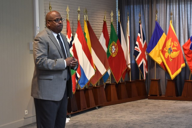 Randy Stephenson, Employment Readiness Program manager at U.S. Army Garrison Benelux, addresses the audience during the Benelux Employment and Career Expo Sept. 5, 2019, on SHAPE, Belgium. In his address, Stephenson encouraged attendees to visit different booths and learn about career, volunteer and educational opportunities in the Benelux.