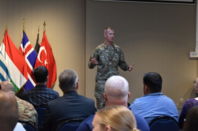 Army Col. Sean Hunt Kuester, garrison commander for U.S. Army Garrison Benelux, addresses the audience during the Benelux Employment and Career Expo Sept. 5, 2019, on SHAPE, Belgium. In his address, Kuester encouraged attendees to explore their interests and passions in the community.