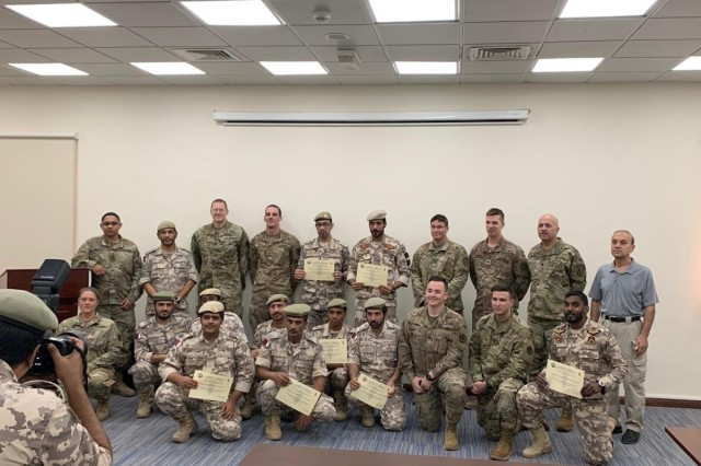 Members of the West Virginia and New Jersey Army National Guard pose for a photo with representatives of the Qatari Emiri Land Forces (QELF) at the conclusion of a Tactical Combat Casualty Care (TCCC) subject matter expert exchange Sept. 12, 2019. The weeklong event, a part of the National Guard Bureau's State Partnership Program, provided an opportunity to share knowledge and best practices on TCCC with the QELF to better enhance their performance and understanding of basic lifesaving techniques.