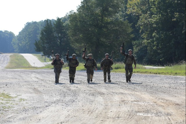The 75th Ranger Regiment team finishes the final event of the Ammunition Transfer Holding Point (ATHP) Team of the Year event at Ft. Pickett, Virginia. The final portion of the event included displacing the ATHP and a 12-mile road march requiring the teams to identify foreign ammunition along the way.