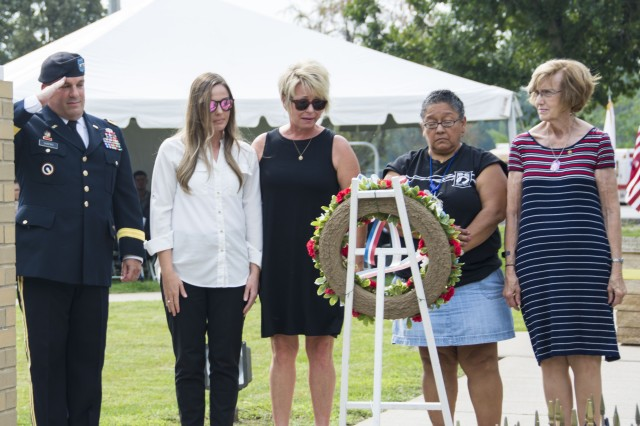 Maj. Gen. Steven Shapiro, commanding general, U.S. Army Sustainment Command, salutes a remembrance wreath at the 9/11 Memorial, Rock Island Arsenal, Illinois, Sept. 11, flanked by Gold Star Family members Paula Steele, mother of Capt. Joshua Steele; Annie Cox, spouse of Staff Sgt. Nathan Cox; Jaimie Johnston, spouse of Cpl. BJ Luxmore; and Laura Mathena, spouse of Sgt. 1st Class Basil Mathena. (Photo by Linda Lambiotte, ASC Public Affairs)