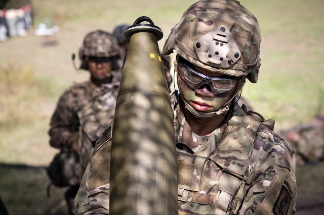 U.S. Army Pvt. Rafael Blas, a cannon crewmember assigned to Chaos Battery, 4th Battalion, 319th Airborne Field Artillery Regiment, 173rd Airborne Brigade, carries a 155mm towed M777 Howitzer round in preparation to fire, during a live fire exercise as part of Saber Junction 19 (SJ19) at the 7th Army Training Command's Grafenwoehr Training Area, Germany, Sept. 11, 2019. SJ19 is an exercise involving nearly 5,400 participants from 16 ally and partner nations at the U.S. Army's Grafenwoehr and Hohenfels Training Areas, Sept. 3 to Sept. 30, 2019. SJ19 is designed to assess the readiness of the U.S. Army's 173rd Infantry Airborne Brigade to execute land operations in a joint, combined environment and to promote interoperability with participating allies and partner nations.