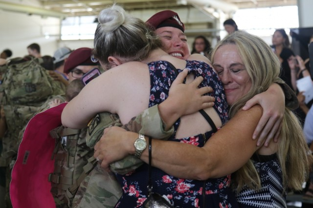 An XVIII Airborne Corps Soldier is greeted by her family Sept. 15, 2019, at Pope Army Airfield following the return of the final contingent of XVIII Airborne Soldiers to return from the Middle East. The Corps was on a more than 12-month deployment as the Combined Joint Task Force Operation Inherent Resolve headquarters. (U.S. Army photo by Pfc. Daniel J. Alkana/22nd Mobile Public Affairs Detachment)