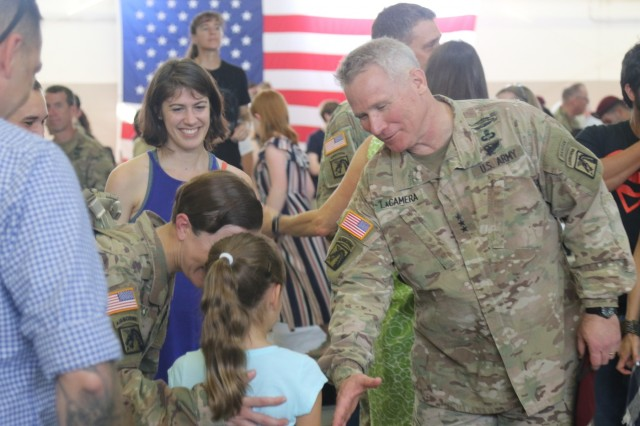 Lt. Gen. Paul J. LaCamera, commander, XVIII Airborne Corps, greets families Sept. 15, 2019 at Pope Army Airfield, Fort Bragg, N.C., following the Corps' return from a more than 12-month deployment to the Middle East as the Combined Joint Task Force Inherent Resolve headquarters. LaCamera, along with Command Sgt. Maj. Paul W. Albertson and 152 Soldiers, arrived at Pope Army Airfield to the cheers of family and fellow service members. (U.S. Army photo by Pfc. Daniel J. Alkana/22nd Mobile Public Affairs Detachment)