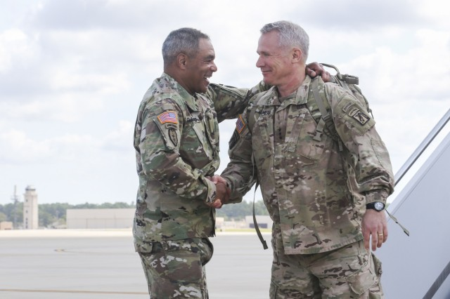 Lt. Gen. Paul J. LaCamera, commander, XVIII Airborne Corps, is greeted on the flight line by Gen. Michael X. Garrett, commander, U.S. Army Forces Command, at Pope Field, Fort Bragg, N.C., Sept. 15, 2019. The XVIII Airborne Corps was the headquarters element of Combined Joint Task Force Operation Inherent Resolve, where they were deployed to Iraq and Kuwait for the past 12 months. (U.S. Army photo by Pfc. Daniel J. Alkana, 22nd Mobile Public Affairs Detachment).