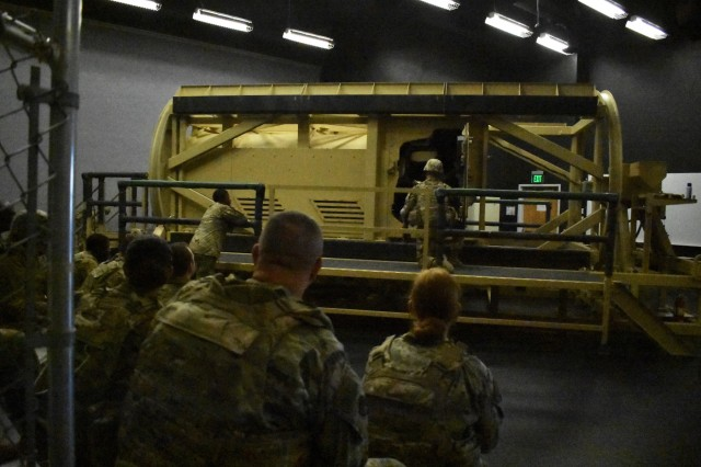 U.S. Soldiers in Headquarters, Headquarters Company, 30th Armored Brigade Combat Team, practice vehicle roll-over and egress training with the HEAT (Humvee Egress Assistance Trainer) at Fort Bliss, Texas, September 13, 2019.  The training teaches Soldiers how to safely exit a military vehicle after becoming disoriented in the case of an accident or roll-over. (U.S. Army National Guard photo by Lt. Col. Cindi King)