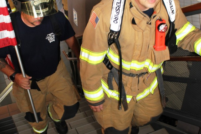 Fort Rucker firefighters make their way up the center stairwell of Bldg. 5700 at the start of the fourth annual 9/11 Memorial Stair Climb Sept. 9.