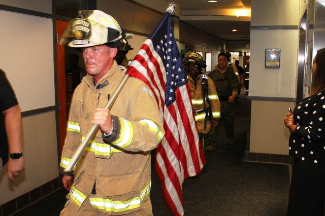 Fort Rucker firefighters walk through the halls of Bldg. 5700 during the fourth annual 9/11 Memorial Stair Climb Sept. 9.