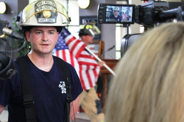 Staff Sgt. Christopher Pickering, Fort Rucker firefighter, is interviewed by the local press during the fourth annual 9/11 Memorial Stair Climb Sept. 9.