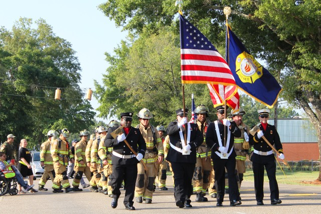 About 50 firefighters, Directorate of Public Safety personnel and supporters from the post took part in the Fort Rucker 9/11 Stephen Siller Moving Tribute Sept. 11 at the Fort Rucker Fire Department where the group, escorted by post firetrucks and community police, walked about 2 � miles across Fort Rucker in honor of Siller and the other lives lost on 9/11.