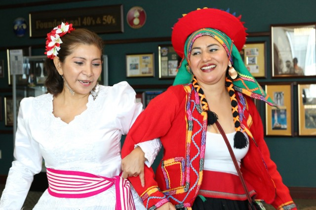 Eva Harris, (left), and Erika Schultz dress in traditional Peruvian costumes, representing coastal and mountain areas of the country, at Team Redstone's Hispanic Heritage Month celebration event, Sept. 12, at the Sparkman Center on Redstone Arsenal, Alabama.