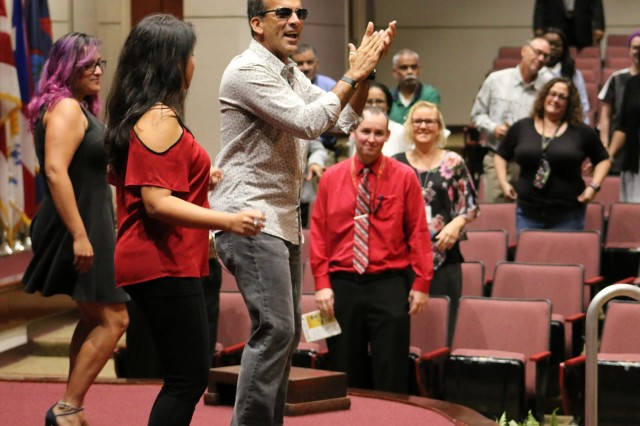 Jose Matienzo, a NASA employee, demonstrates Latino dances with a couple of friends at Team Redstone's Hispanic Heritage Month celebration event, Sept. 12, at the Sparkman Center on Redstone Arsenal, Alabama.