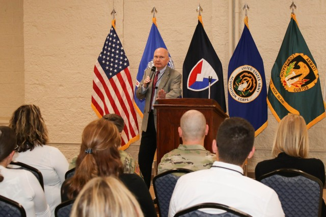 Michael Hutchison, deputy to the commanding general, Army Sustainment Command, speaks to a crowd of approximately 75 Army Contracting Command-Rock Island supervisors, interns and recent hires, in Heritage Hall, Sep. 10. (Photo by Liz Glenn, ACC-RI Public Affairs)