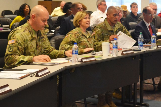From left, Lt. Col. Anthony J. Kazor, Commander, Radford Army Ammunition Plant, Brig, Gen. Michelle M.T. Letcher, Commanding General, Joint Munitions Command, Col. Luis Ortiz, Commander, Pine Bluff Arsenal, and Joseph R. Kennedy, Jr., Commander's Representative, Holston Army Ammunition Plant, prepare for the Quarterly Briefing, held Sept. 16 at the Arsenal.