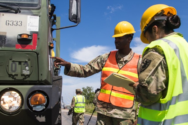 Spc. Alshton Stewart, Task Force 11, 7th Transportation Brigade and Pvt. Andrea Altamirano, Task Force 11, 7th Transportation Brigade, verify military equipment being transported to Singing River Island, Mississippi during the Logistics Over-The-Shore operation in Joint Readiness Exercise 2019.  The JRE allows the Army to train transportation units, which are essential for deploying U.S. combat power around the world.  (U.S. Army Photo by Pfc. Joshua Cowden / 22nd Mobile Public Affairs Detachment)