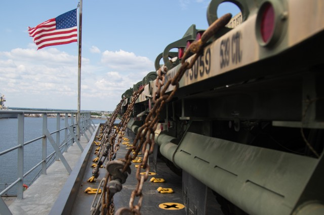 U.S Army vehicles aboard National Defense Reserve Fleet vessel, MV Cape Rise, await to be offloaded during a Joint Readiness Exercise Sept. 14, 2019. The JRE tests and validates the Army and Air Force's ability to deploy a unit and operate as part of an integrated, joint, cohesive team. (U.S. Army Photo by Pfc. Joshua Cowden / 22nd Mobile Public Affairs Detachment)