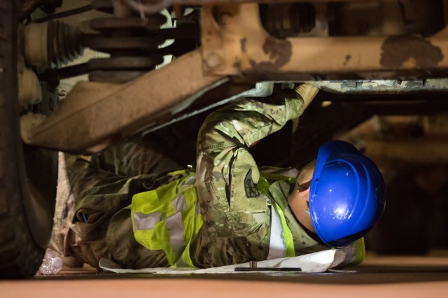 Spc. Jon Hodgson, Task Force 11, 7th Transportation Brigade (Expeditionary), inspects a vehicle aboard National Defense Reserve Fleet vessel, MV Cape Rise during a Joint Readiness Exercise Sept. 14, 2019. The equipment belongs to 4th Infantry Brigade Combat Team, 25th Infantry Division and was being transported from Anchorage, Alaska to Camp Shelby, Miss. (U.S. Army Photo by Pfc. Joshua Cowden / 22nd Mobile Public Affairs Detachment)