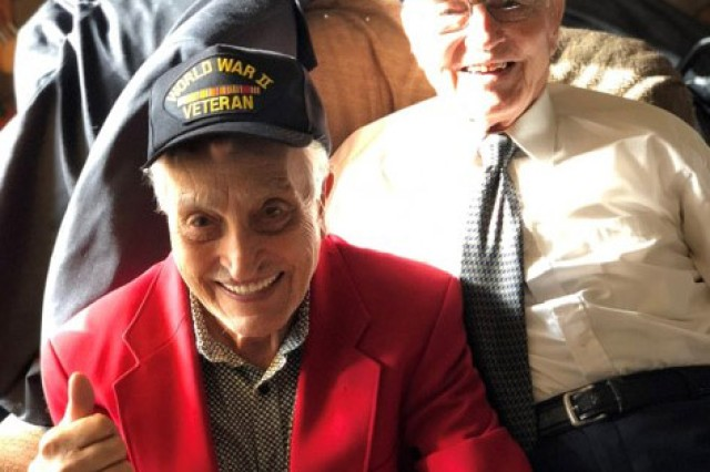 Brothers Ed and Ted Sikora pose for a photo wearing World War II veteran caps in October 2018.