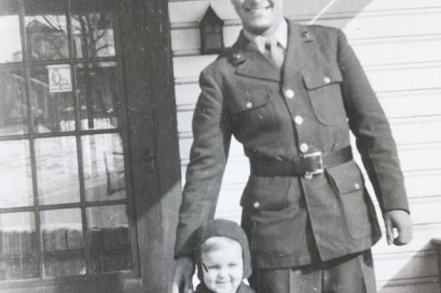 Ted Sikora visits with his nephew when he is home on furlough during World War II.