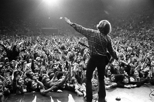 While on tour with Credence Clearwater Revival sometime between 1968 and 1972, John Fogerty wows the crowds at a concert.