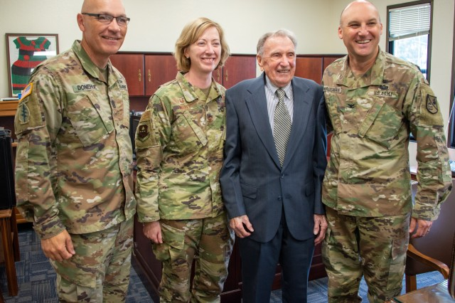Alfred Loikits has his photo taken with Defense Language Institute Commandant Col. Gary Hausman, Assistant Commandant Col. Stephanie Kelley, and Command Sgt. Maj. Thomas Donehue during a visit to the Presidio of Monterey. While in the Army during World War II, Loikits translated the testimony of Nazi war criminals during the Nuremburg trials.