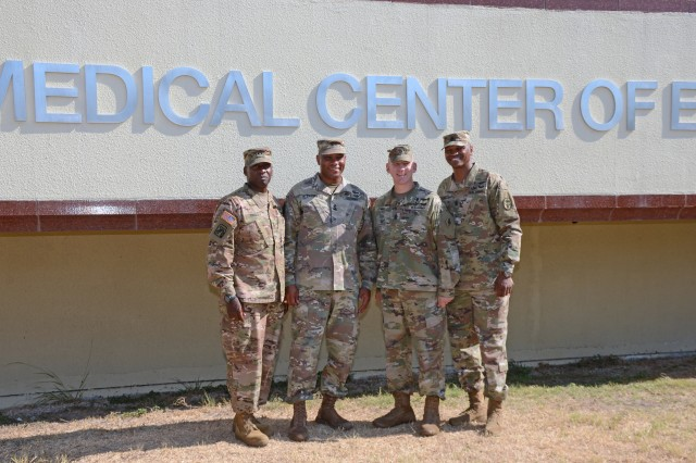 """(Left to Right) Maj. Gen. R. Scott Dingle, the acting Surgeon General of the U.S. Army and acting commander, MEDCOM, with Maj. Gen. Patrick D. Sargent, commander, MEDCoE, Cmd. Sgt. Maj. William """"Buck"""" O'Neal, command sergeant major, MEDCoE, and Cmd. Sgt. Maj. Michael L. Gragg, command sergeant major, MEDCOM."""