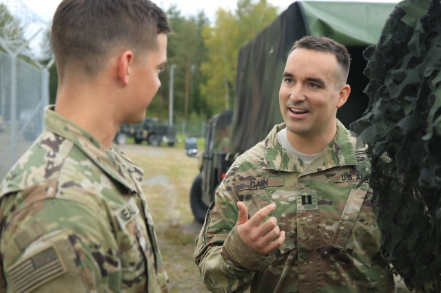 2nd Lt. Shane Neal, and Cpt. Douglas Gain, officers with the Cyber and Electromagnetic Activities Team, discuss their plans during Exercise Saber Junction 2019 (SJ19) at the Grafenwoehr Training Area, Germany, Sept. 12, 2019. SJ19 is an exercise involving nearly 5,400 participants from 16 ally and partner nations at the U.S. Army's Grafenwoehr and Hohenfels Training Areas, Sept. 3 to 30 Sept. 2019. SJ19 is designed to assess the readiness of the U.S. Army's 173rd Infantry Airborne Brigade to execute land operations in a joint, combined environment and to promote interoperability with participating allies and partner nations. (U.S. Army Photo by Spc. Joseph Knoch)