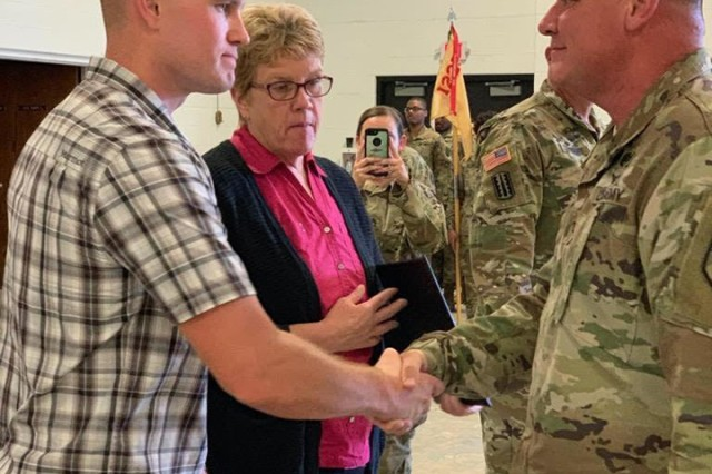 Col. Scott Meyers, director of human resources, Michigan National Guard Joint Force Headquarters, Lansing, Mich., presents the Michigan National Guard Lifesaving medal to the family of Staff Sgt. Justin Skaggs during a ceremony at Camp Grayling Joint Maneuver Training Center, Mich., Sept. 14, 2019. Skaggs, a Soldier with the 1225th Support Battalion, Detroit, Mich., died after a motorcycle accident May 23. His decision to be an organ donor saved several lives.
