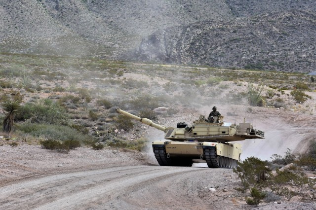 U.S. Soldiers with Delta Troop, 1-150th Cavalry Regiment, 30th Armored Brigade Combat Team, operate an M1A1 Abrams Main Battle Tank as part of Armament Accuracy Checks (AACs) and bore sight procedures leading up to the Live Fire Accuracy Screening Test (L-FAST) in the vicinity of Fort Bliss, Texas, Sept. 16, 2019. The unit is mobilized to Operation Spartan Shield in the Middle East with units from the North Carolina, South Carolina, West Virginia and Ohio Army National Guard. (U.S. Army National Guard photo by Lt. Col. Cindi King)