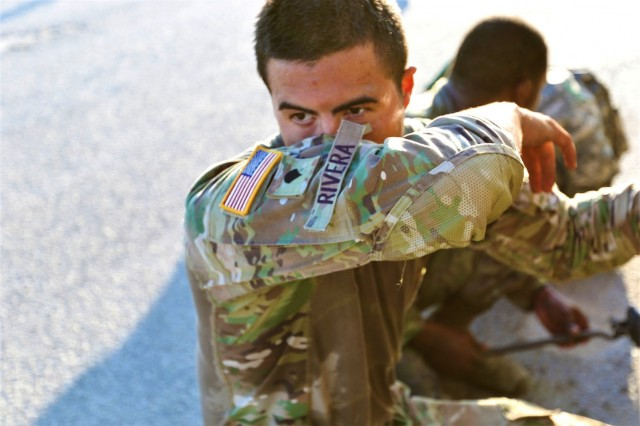 Spc. Jovanni Rivera, Headquarters and Headquarters Company, 504th Military Intelligence Brigade, wipes sweat from his face, Sep. 6, 2019, Fort Hood, Texas. It was only early morning, but the heat was on during the Ready Wrench Rumble competition. (U.S. Army photo by Sgt. Melissa N. Lessard)