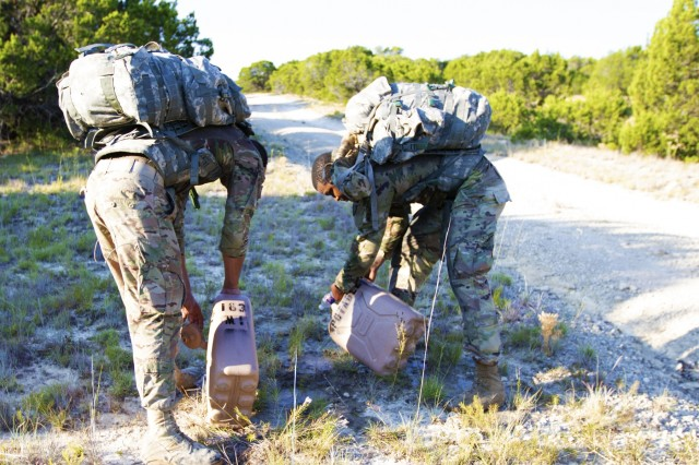 Spc. Jovanni Rivera, left, and Spc. Brandon Gibbons, right, dump water out of water cans, Sep. 6, 2019, Fort Hood, Texas. The Ready Wrench Rumble consisted of nine events. (U.S. Army photo by Sgt. Melissa N. Lessard)