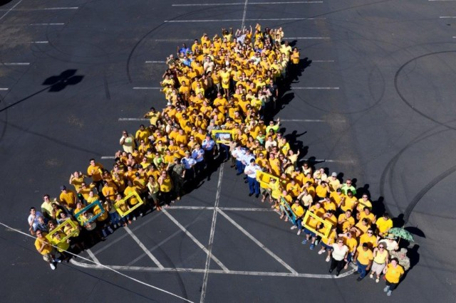 Hawaii-based service members from every branch of the military, DoD personnel and military/DoD families form a yellow suicide awareness ribbon in support of National Suicide Prevention Awareness Month at Joint Base Pearl Harbor-Hickam.