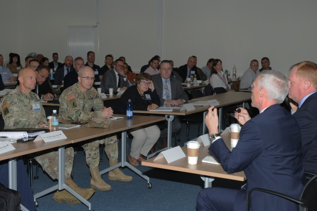 Lt. Gen. Ronald J. Place, the new Director of the Defense Health Agency, center, and Brig. Gen. Ron Stephens, Regional Health Command Europe commanding general, left, listen in during a panel discussion with combatant command surgeons general Sept. 11 at the Sembach Leadership Development Center. Place was the Keynote Speaker at the TRICARE Eurasia Africa Commanders and Stakeholders Meeting Sept 9-13. During his visit, he also met with senior military leaders, Surgeons General from Unified Combatant Commands, and toured the Stuttgart Army Health Clinic.