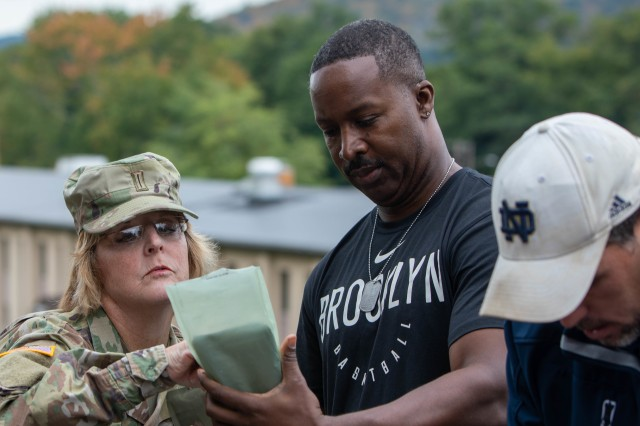 "New York Army National Guard Command Chief Warrant Officer Jacquiline O'Keefe explains how to prepare an MRE to Kevin Parker, during a ""boss lift"" to Camp Smith Training Site in Cortlandt Manor, N.Y. on Monday, Sept. 16, 2019. Twenty employers from the Albany, N.Y. area and Long Island visited Camp Smith Training Site to get a first-hand look at New York Army National Guard training, including using electronic simulators and firing the M-4 and M-9, as part of the Employer Support of the Guard and Reserve program."