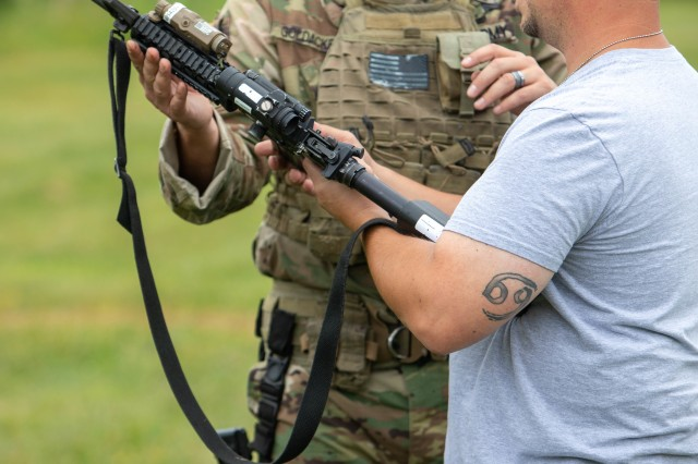 "Jerry Anthis, a service manager for Sinclair Fuel on Long Island, gets hints about the M-4 carbine from New York Army National Guard Sgt. 1st Class Fredrick Goldacker during a ""boss lift"" at Camp Smith Training Site in Cortlandt Manor, N.Y. on Monday, Sept. 16, 2019. Twenty employers from the Albany, N.Y. area and Long Island visited Camp Smith Training Site to get a first-hand look at New York Army National Guard training, including using electronic simulators and firing the M-4 and M-9, as part of the Employer Support of the Guard and Reserve program."