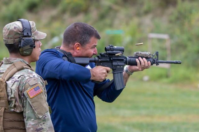 "Mathew Zink, the training director for the Bricklayers and Allied Craftworkers Union in Albany, N.Y. fires an M-4 carbine during a ""boss lift"" at Camp Smith Training Site in Cortlandt Manor, N.Y. on Monday, Sept. 16, 2019, as New York Army National Guard Sgt. Omar Ortega, a member of the 1st Battalion 69th Infantry looks on..Twenty employers from the Albany, N.Y. area and Long Island visited Camp Smith Training Site to get a first-hand look at New York Army National Guard training, including using electronic simulators and firing the M-4 and M-9, as part of the Employer Support of the Guard and Reserve program."