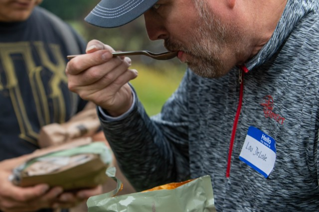 "Louis Delisle, an executive from Ball Beverage & Packaging in Saratoga Springs, N.Y., samples an MRE during a ""boss lift"" to Camp Smith Training Site in Cortlandt Manor, N.Y. on Monday, Sept. 16, 2019. Twenty employers from the Albany, N.Y. area and Long Island visited Camp Smith Training Site to get a first-hand look at New York Army National Guard training, including using electronic simulators and firing the M-4 and M-9, as part of the Employer Support of the Guard and Reserve program."