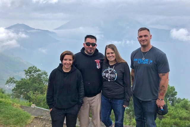 (left) Rachael, Kory, and Dani Jones, along with Josh Karabatsos, take time for a photo at a lookout between Los Robles and San Andreas, Guatemala, during a recent humanitarian trip in August 2019. Kory Jones and Karabatsos are firefighters with the Tooele Army Depot Fire Department, Tooele, Utah, and used personal leave to travel to Guatemala to volunteer with a local Utah organization, Humanitize Expeditions.
